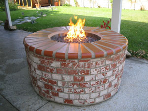 Brick fire pit with fireglass